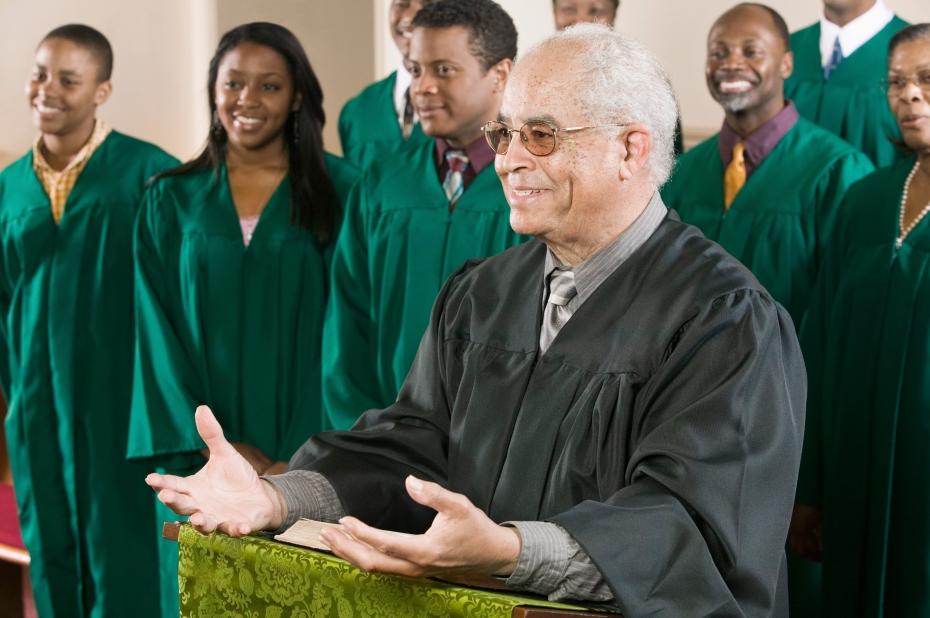 Minister Preaching in Front of Gospel Choir